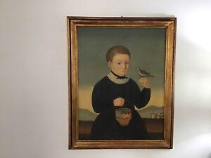 EUROPEAN SCHOOL (19TH CENTURY FOLK ART)OIL ON CANVAS PORTRAIT OF BOY.