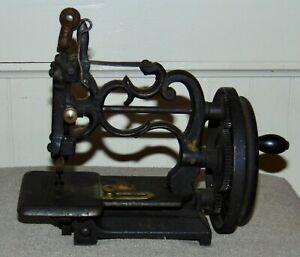 ANTIQUE CAST IRON HAND CRANK TOY SEWING MACHINE NETTLETON RAYMOND VERMONT?