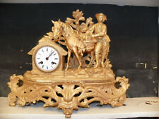 EARLY GILT CLOCK OF MAN WITH HORSE  16060