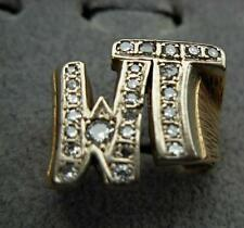 14k gold , 2 letter  W  T  ring  set with diamonds size 11 weights  15.1  gr.