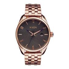 Relojes de pulsera Nixon oro de acero inoxidable