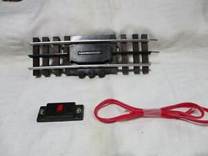 1 GAR GRAVES REMOTE UNCOUPLER  WITH PUSH BUTTON. O27  SCALE.  NEW CONDITION.