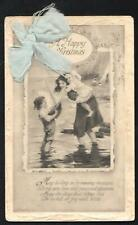 EARLY 1900's VINTAGE HAPPY CHRISTMAS CHILDREN POSTCARD with BLUE RIBBON - USED