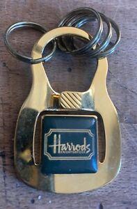Vintage Harrods gold tone metal keyring. Never used.