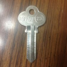 Taylor 23  and CO5  on back uncut key blank USA