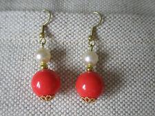 earrings on gold coloured hooks- pierced ears Hand made orange & white bead drop
