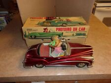 VINTAGE PHOTOING ON CAR BATTERY OPERATED TIN CAR MADE IN CHINA  ME 630