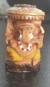 A carved wooden representation of the Hindu God Ganesh India
