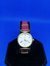 ladies timex gold tone dress watch,white face & gold hands,burgundy strap.#b2.