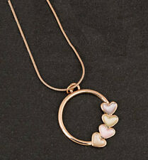 Muted Tones Ring Of Hearts Necklace from Equilibrium