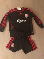 "Liverpool FC boys retro shorts 24/26, Shirt 24/26"".  Carlsberg."