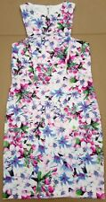 LADY'S SUMMER CASUAL/BEACH/PARTY DRESS. FLORAL DESIGN. WHITE BACKGROUND. SIZE 8