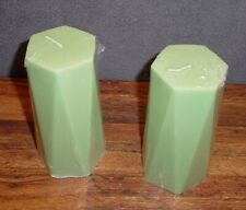 Pair of green hexagon shaped pillar candles.