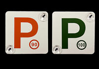 A set of 2 Reversible P-Plates with suction cups, suitable for NSW Drivers