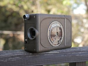 Bell And Howell Filmo16mm Magazine Movie Camera Looks Good and Works Great!!!