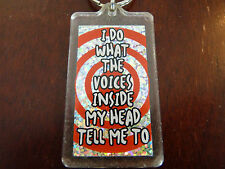 Collectible Plastic Keyring '' I Do What the Voices Inside my Head Tell Me To ''