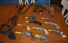 A REPAIR MANS DREAM ANTIQUE CAP GUNS COLLECTION IN ROUGH SHAPE NEEDS LOVING