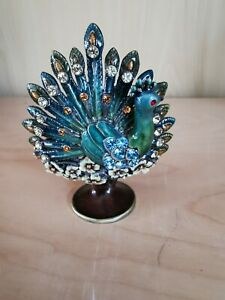 Pretty metal peacock ornament with orange & blue diamontes