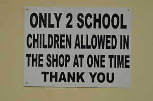 White plastic shop sign printed black only 2 school children HOLED, DRILLED