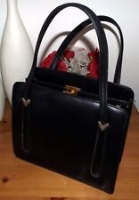 Asprey London, vintage black leather spacious handbag. 3 large compartments