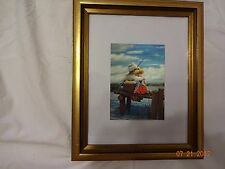 Collectible picture in attractive gold frame