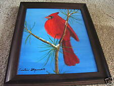 Cardinal setting in a tree with a black frame