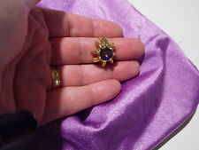 Ladies Vintage gold coloured ring with sparkly purple stone.Costume jewellery.