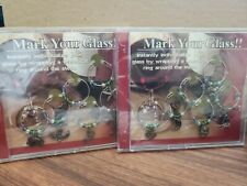2 SETS OF SIX (6) WINE BOTTLE RING SILVER COLOR METAL CHARMS, NEW IN CASE!!!