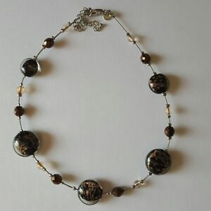 A beautiful wire strung necklace with glass beads by M& S