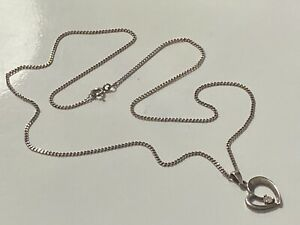 STERLING SILVER CHAIN AND PENDANT LOT 399