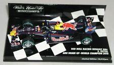 Voitures Formule 1 miniatures blancs sur Sebastian Vettel