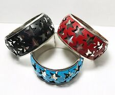 Set Of Three Vintage Star Theme Bangle Bracelets In Blue Black And Red