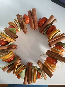 Autumnal/christmas dried fruit and cinnamon wreath/ring