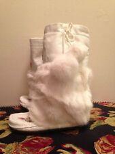 White leather mukluks with rabbit fur. Worn By Celebrities Like Paris Hilton