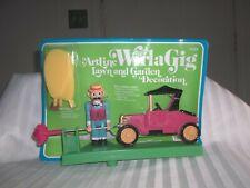 Vintage WirlaGig #5025 man w/ antique car windspinner windmill