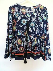 Near new ZEN GARDEN top. Sz S about 10-12. Black with floral.