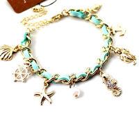 Charm bracelet w/ steering wheel, starfish, seahorse, octopus, anchor, seashell