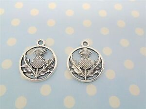 30 x THISTLE CHARMS SCOTTISH FLOWER  IN CIRCLE TIBETAN ANTIQUE SILVER COLOUR