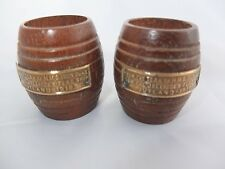 An unusual pair of early 20th Century, barrel shaped, teak match holders