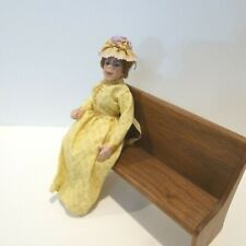 MINIATURE LADY DOLL WEARING YELLOW DRESS HAND SCULPTED