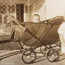 Cute baby Boy pops head up from 1940s stroller w sister close PHOTO old vintage