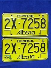 ALBERTA LICENSE PLATES SET PAIR COMMERCIAL 2X 7258 EXP 1084  CANADA VERY NICE