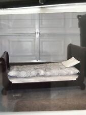 Antique Wooden Rope Doll Bed with mattress and pillows.