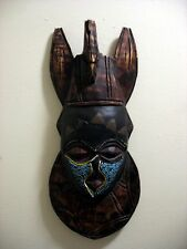 A VINTAGE AFRICAN WOOD CARVED TRIBAL MASK WALL HANGING WITH BRASS AND BEADS TRIM