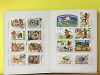 Worldwide Stamps 65 Different Stamps in a New 8 Pages Stamp Collection Book (#1)