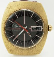 Vintage 1970's Kaltron Day Date Gold Tone Watch 17 Jewels Black Red White Dial