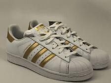 adidas Originals Kids' Superstar, White/Gold Metallic/Blue, 5.5 M Us Big Kid