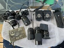Canon A1 35mm Cameras (2), 5 Lenses, 2 Flashes, 2 Teleconverters Huge Lot !