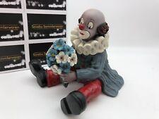 Gilde Clown Sitzend mit Blumen 13 cm. Top Zustand.