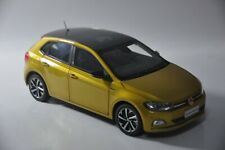 Volkswagen All New Polo Plus car model in scale 1:18 gold